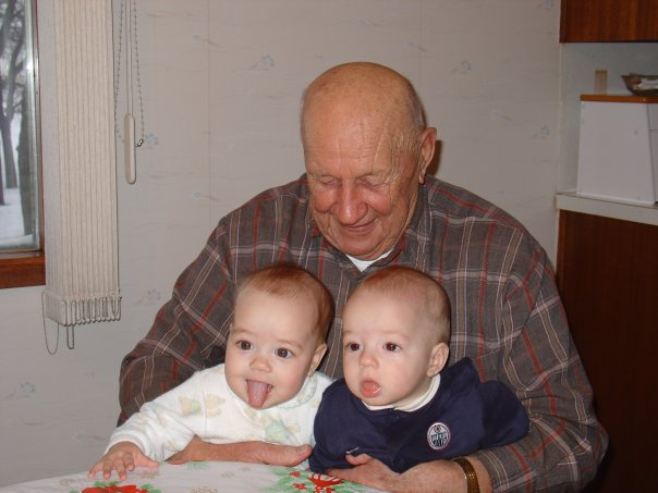 Grandpa holding Vivian and William.